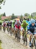 The Peloton on a Cobbled Road- Tour de France 2014 Royalty Free Stock Image
