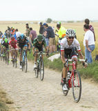 The Peloton on a Cobblestone Road - Tour de France 2015 Royalty Free Stock Photography