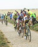 The Peloton on a Cobblestone Road - Tour de France 2015 Royalty Free Stock Photos