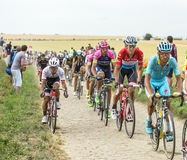 The Peloton on a Cobblestone Road - Tour de France 2015 Stock Photography