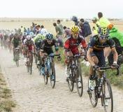 The Peloton on a Cobblestone Road - Tour de France 2015 Stock Image