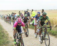 The Peloton on a Cobblestone Road - Tour de France 2015 Stock Images