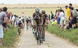 The Peloton on a Cobblestone Road - Tour de France 2015 Stock Photo