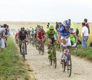The Peloton on a Cobblestone Road - Tour de France 2015 Royalty Free Stock Image
