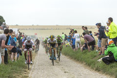 The Peloton on a Cobblestoned Road - Tour de France 2015 Royalty Free Stock Photo