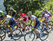 The Peloton on Col d'Aspin - Tour de France 2015. Col D'Aspin,France- July 15,2015: Cyclists form various teams climbing in the peloton the road to Col D'Aspin Royalty Free Stock Image