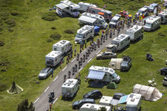 The Peloton. Col de Pailheres,France- July 06 2013: The peloton climbing the road to Col de Pailheres in Pyrenees Mountains, through a row of caravans and Stock Photography