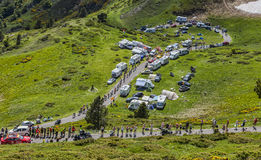 The Peloton. Col de Pailheres,France- July 06 2013: The peloton climbing the road to Col de Pailheres in Pyrenees Mountains, through a row of caravans and Stock Images