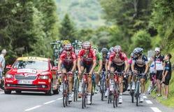 The Peloton. Col du Tourmalet, France - July 24,2014: Three cyclists from Lotto Belisol Team (Tony Gallopin, Adam Hansen,  Jurgen Van den Broeck) lead a part of Stock Photos