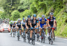 The Peloton on Col du Tourmalet - Tour de France 2014. Col du Tourmalet, France - July 24,2014: The peloton climbing the road to Col de Tourmalet in the stage 18 Royalty Free Stock Photos