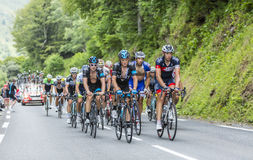 The Peloton on Col du Tourmalet - Tour de France 2014. Col du Tourmalet, France - July 24,2014: The peloton climbing the road to Col de Tourmalet in the stage 18 Royalty Free Stock Photo