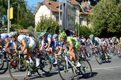 Peloton of the cycle race. Is racing in the street of the French town Pau Royalty Free Stock Photo