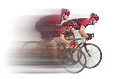 Peloton of cyclists sprints to the finish. Isolated on white background stock images