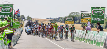 The Peloton Delayed. Saint Aoustrille, France-July 12,2013: The delayed peloton at the intermediate sprint line during the stage 13 of the edition 100 of Le Tour Royalty Free Stock Image