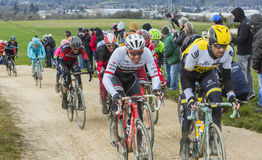 The Peloton on a Dirty Road - Paris-Nice 2016 royalty free stock photography