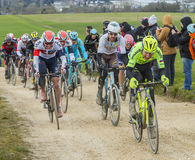 The Peloton on a Dirty Road - Paris-Nice 2016 Stock Photography