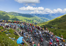 The Peloton in Mountains. Col de Peyresourde,France- July 23, 2014: The peloton climbing the road to Col de Peyresourde in Pyrenees Mountains during the stage 17 Stock Image