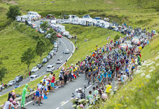 The Peloton in Mountains. Col de Peyresourde,France- July 23, 2014: The peloton climbing the road to Col de Peyresourde in Pyrenees Mountains during the stage 17 Stock Photography