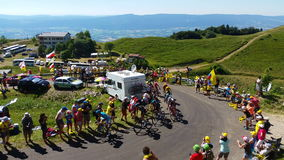 The peloton in mountains - Tour de France 2016. COL DU GRAND COLOMBIER,FRANCE-JUL 17: The peloton including Chriss Froome in Yellow Jersey climbing the road to stock video footage