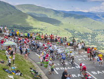 The Peloton in Mountains - Tour de France 2014. Col de Peyresourde,France- July 23, 2014: The peloton climbing the road to Col de Peyresourde in Pyrenees stock image