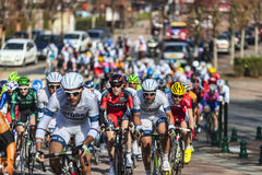 The Peloton- Paris Nice 2013 in Nemours. Saint-Pierre-lès-Nemours,France- March 4, 2013: Image of the peloton riding fastly, during the first stage of the Stock Image