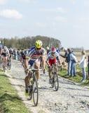 The Peloton- Paris Roubaix 2015. Carrefour de l'Arbre,France - April 12,2015: The Slovak cyclist Peter Sagan of Tinkoff-Saxo Team, and the Norwegian cyclist Stock Photography