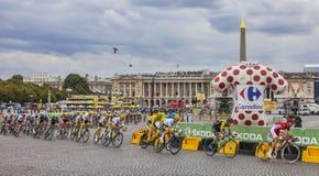 The Peloton in Paris - Tour de France 2017. Paris, France - 23 July, 2017: The peloton, including Chriss Froome in Yellow Jersey, riding in Place de la Concorde Stock Photography