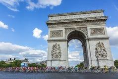 The Peloton in Paris - Tour de France 2016. Paris, France - July 24, 2016: The peloton (including the major distinctive jerseys) passing by the Arch de Triomphe Royalty Free Stock Photos
