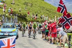 The Peloton in Pyrenees Mountains Stock Photo