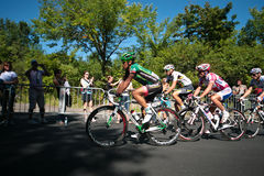 The Peloton racing with Yukiya ARASHIRO leading Royalty Free Stock Photo