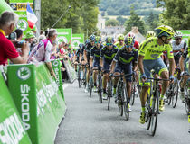 The Peloton - Tour de France 2016. Bouille-Menard,France - July 4, 2016: The Colombian cyclist Nairo Quintana of Movistar Team rides in the pack during the stage Royalty Free Stock Image