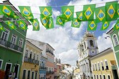 Pelourinho Salvador Brazil with Brazilian Flag Bunting. Brazilian flag bunting fluttering over historic city center colonial architecture of Pelourinho Salvador Royalty Free Stock Image