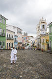 Pelourinho Salvador Brazil Historic City Center Skyline. SALVADOR, BRAZIL - MARCH 12, 2015: Candomble priest in all white stands on the cobblestone streets in Stock Images