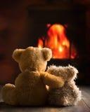 Peluches por el fuego Imagen de archivo libre de regalías