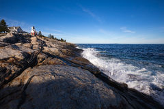Pemaquid Point Lighthouse above rocky coastal rock formations on Stock Images