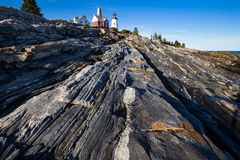 Pemaquid Point Lighthouse above rocky coastal rock formations on Royalty Free Stock Photography