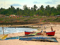 PEMBA, MOZAMBIQUE - 5 DESEMBER 2008: Boats lying on the beach. Stock Image
