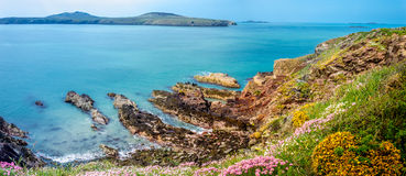 Pembroke Cliffs. View of the rocky cliffs taken from the Welsh coastal path in Pembroke stock images
