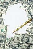 Pen on the $100 banknotes background. Gold pen on the $100 banknotes background Stock Photo