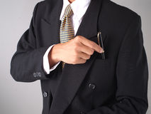 Pen. Businessman picking pen from pocket stock photos