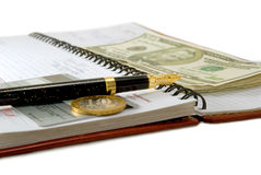 The pen. Bank card, coin, dollars lays on weekly Stock Photography