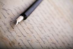 Pen. Old paper background with pen & nibs Royalty Free Stock Image