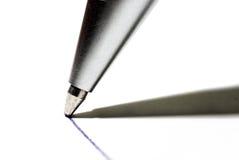 Pen. Writting on white paper Royalty Free Stock Photos