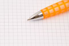 Pen. Closeup of pen on blank paper ruled with squares Stock Photography