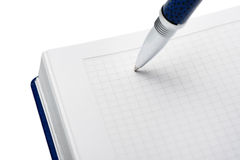 Pen above a notebook stock images