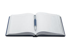 Pen above a notebook Royalty Free Stock Image