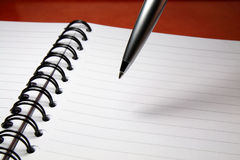 Pen Above Notebook Royalty Free Stock Photo