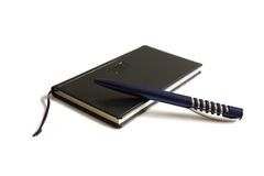 A pen and an address book Royalty Free Stock Images