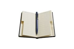 A pen and an address book stock image