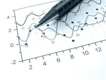 Pen against the chart (in blue) Stock Photography